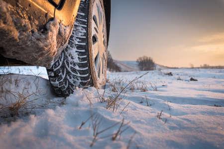 snow landscape: Car tires on winter road
