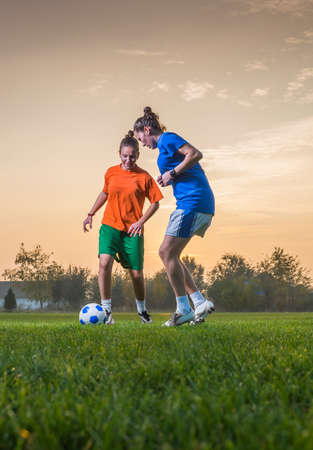 soccer players: two female soccer players on the field