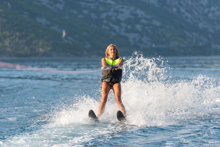 water skiing: a young woman water skiing on a sea Stock Photo