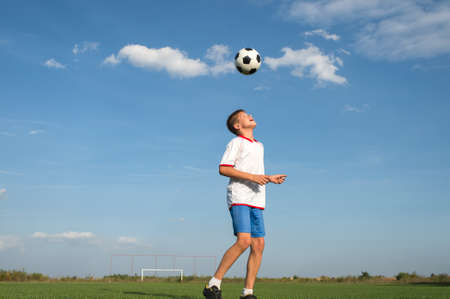 kids  soccer: Soccer Player Head Shooting a Ball Stock Photo