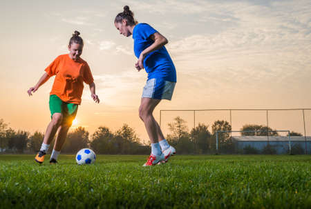 female soccer: Two female soccer players on the field