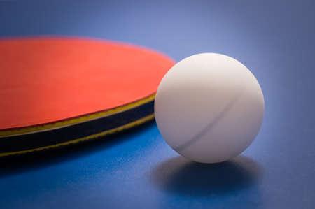 tabletennis: Tabletennis racket and ball on table Stock Photo