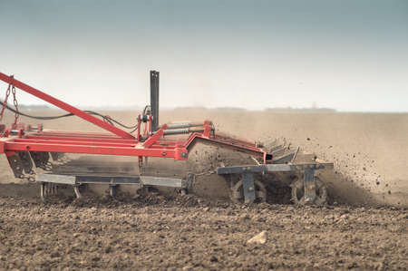 Tractor preparing land for sowing photo