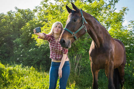 animal beautiful: girl taking a selfie with his horse