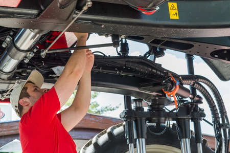 lifted: Auto mechanic working underneath a lifted Stock Photo