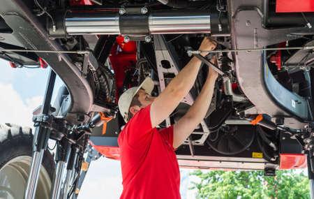 maintenance man: Auto mechanic working underneath a lifted Stock Photo