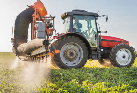 pesticides: tractor spraying pesticides on soy bean