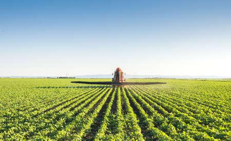 Tractor spraying soybean field 写真素材