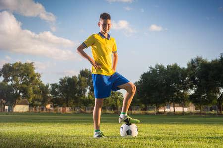 Boy posing on the soccer field
