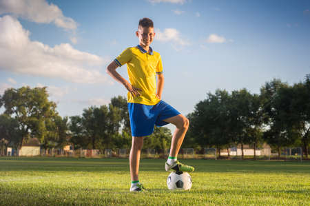 Boy posing on the soccer field