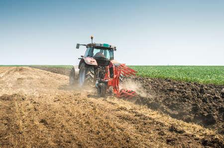 stubble: Tractor plowing the stubble field