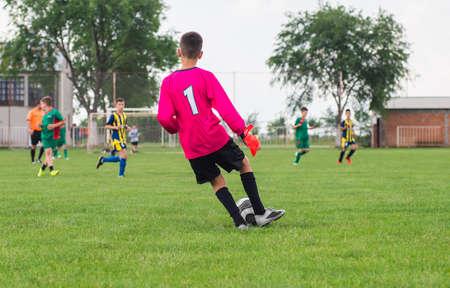 goalkeeper: little soccer goalkeeper with gloves