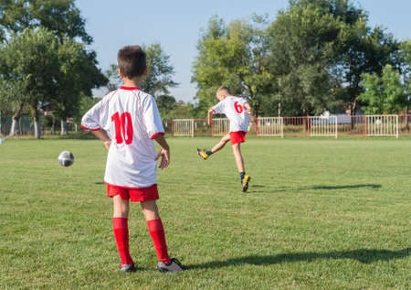 kicking ball: Boys kicking ball at goal