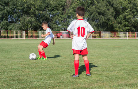 kicking: Boys kicking ball at goal
