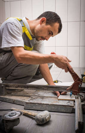 bathroom: Install ceramic tiles in bathroom Stock Photo