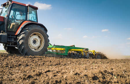 cultivation: Tractor preparing land for sowing Stock Photo
