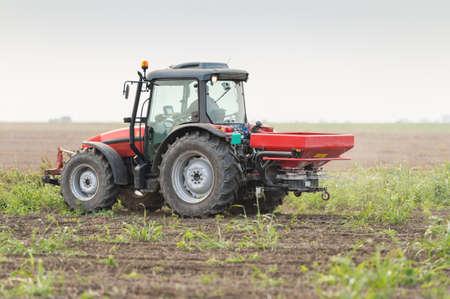 phosphorus: Tractor and fertilizer spreader in field