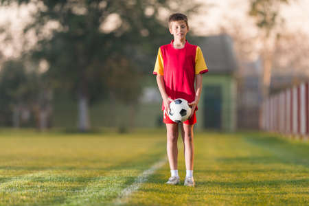 boy ball: Young boy with soccer ball posing for picture