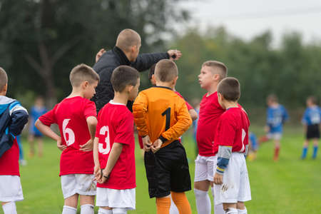 young caucasian: Discussion of the kid soccer team before the match