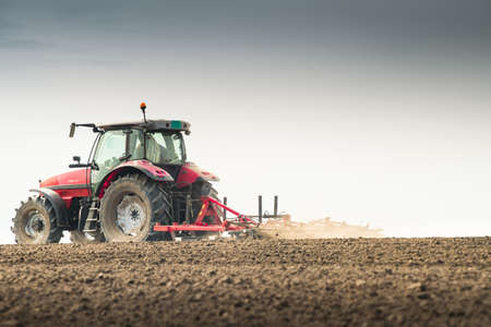 machinery: Tractor preparing land for sowing Stock Photo