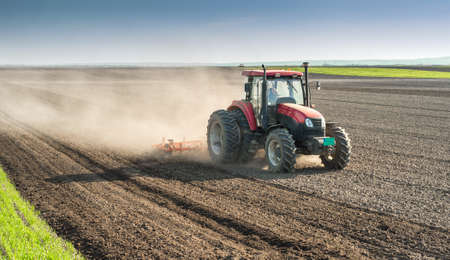 land: Tractor preparing land for sowing Stock Photo