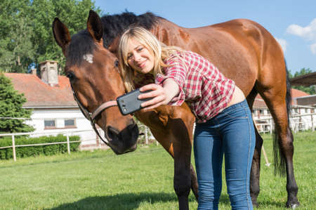 beautiful smile: girl taking a selfie with his horse