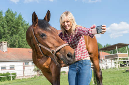 graceful: girl taking a selfie with his horse