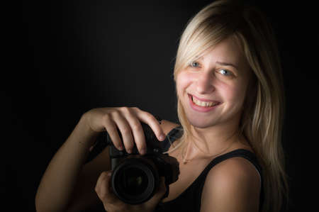 blond girl: pretty young woman with camera Stock Photo