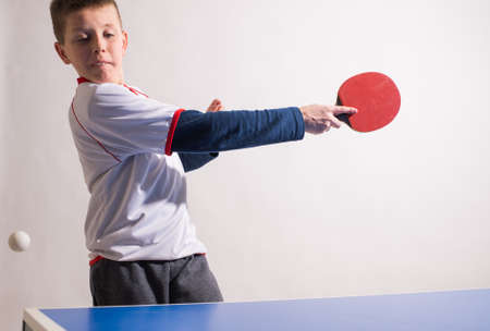 table tennis: little boy playing table tennis