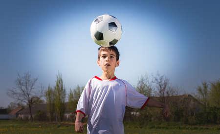 kicking: Boys kicking football on the  field