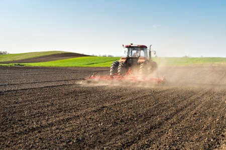 agriculture machinery: Tractor preparing land for sowing Stock Photo
