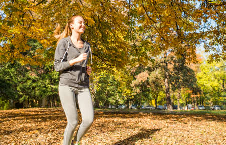 18 19 years: Young girl  jogging in the park