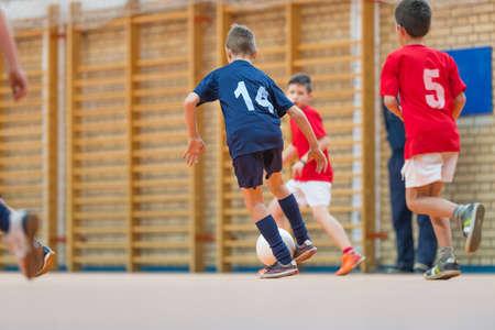 防衛: 屋内サッカー少年 写真素材