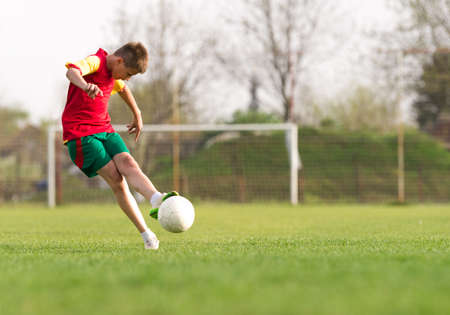 only boys: boys kicking football on the sports field