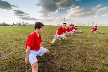 sports field: Kids soccer team exercise on soccer field