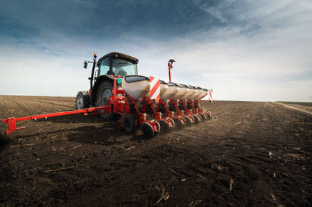 seed drill: Tractor seeding crops at field
