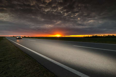 speed car: Car driving on freeway at sunset