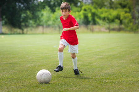 one boy only: Little Boy Shooting at Goal Stock Photo