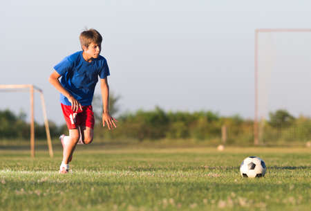 Young boy playing football
