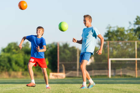 cheerfull: Boy on the football training on the court