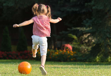 age 5: Little girl Shooting at Goal Stock Photo