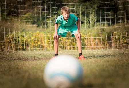 arquero: little soccer goalkeeper in goal Foto de archivo