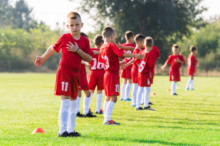 rival rivals rivalry season: Childrens soccer team in the field exercise