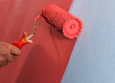 Close up paint roller on the wall.