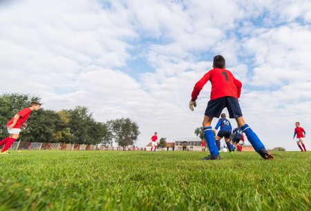 goalkeeper: goalkeeper kids soccer in soccer field
