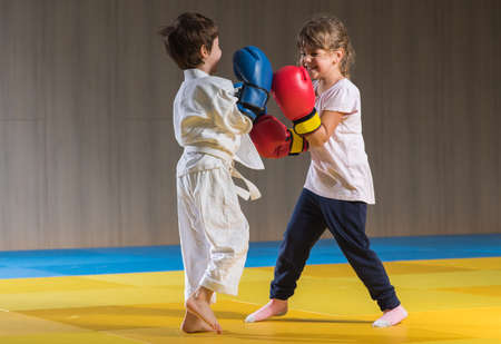 eastern european ethnicity: Young kids with boxing gloves training