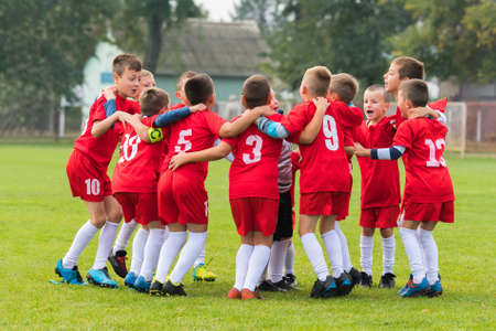 Kids soccer football team in huddle Stock Photo