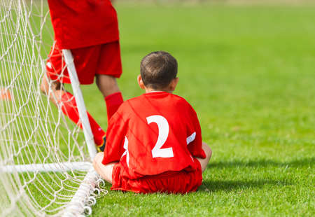 downhearted: Kids soccer waiting in a out Stock Photo