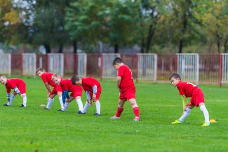 Childrens soccer team in the field exercise