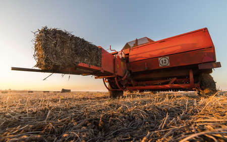 agricultural machinery ejected bale of soybean Stock Photo